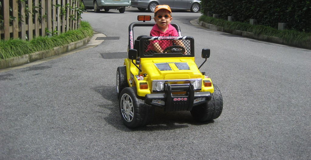Little boy in his first car driving