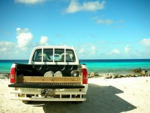 Car at the beach, rear view
