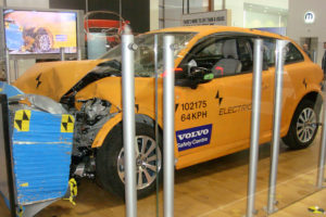 Yellow Volvo C30 electric during a crash test in safety center