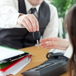 Business scenario: employer handing key to car to employee