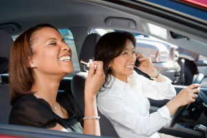 Two women on the road distracted while driving