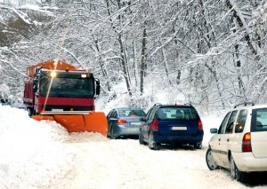 Cars driving trough snow on road