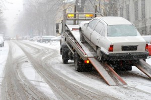 Towing a car on snowy street