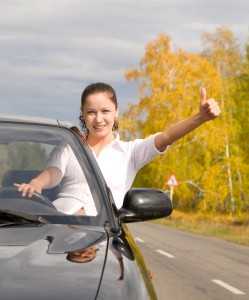 Women on the road, thumbs up