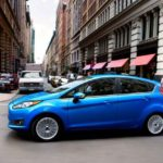 Blue Ford Fiesta in city center