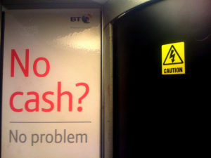 "Text: ""No cash? No problem. Caution!"""